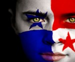 Portrait of a boy with the flag of Panama on his face